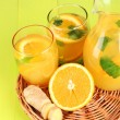 Orange lemonade in pitcher and glasses on wooden table close-up — Lizenzfreies Foto