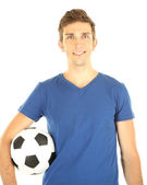 Young soccer player holding ball, isolated on white — Stock Photo