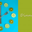 Clock made of kiwi, lime and lemon slices, on color background — Stock Photo