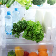 Open refrigerator with vegetarian food — Stok fotoğraf