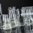 Test tubes on black background — Stock Photo #25903873