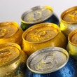 Stock Photo: Metal tins on light yellow tone