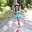 Little girl in roller skates at  park — Stock Photo