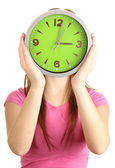 Girl holding clock over face isolated on white — Stock Photo