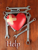 Reconstruction of heart tools on wooden table close-up — Stock Photo