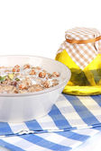 Useful oatmeal in bowl isolated on white — Stock Photo