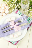 Table setting in violet and pink tones on color wooden background — Stock Photo