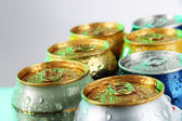 Metal tins on light green tone — Stock Photo