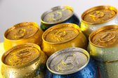 Metal tins on light yellow tone — Stock Photo