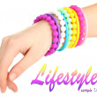 Colorful fashion bracelets on woman hand isolated on white — Stock Photo
