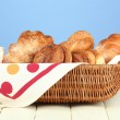Composition with bread and rolls on wooden table, on color background — Stock Photo #26014985