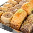 Sweet baklava on tray isolated on white — Stock Photo #26015303