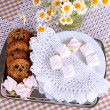 Stock Photo: Cookies and marshmallow on table on checkered tablecloth