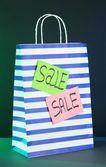 Striped bag on dark background — Stock Photo