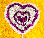 Decorative heart from paper on yellow background — Stock Photo