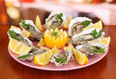 Oysters on table in cafe — Stockfoto