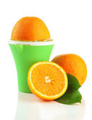 Citrus press and ripe oranges, isolated on white — Stock Photo