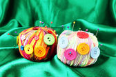 Colorful buttons and multicolor wool balls, on color fabric background — 图库照片