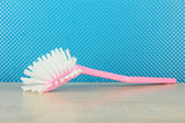 Toilet brush on blue background — Stock Photo