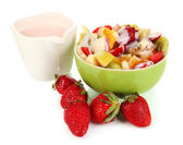 Useful fruit salad of fresh fruits and berries in bowl isolated on white — Stock Photo