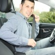 Portrait of young man sitting in the car — Stockfoto