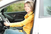 Portrait of young beautiful woman sitting in the car — Stock Photo