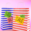 Striped bags on pink background — Stockfoto