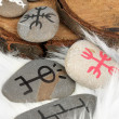 Fortune telling  with symbols on stones on white fur background — Stock Photo