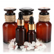 Aroma oils with flowers isolated on white — Stock Photo