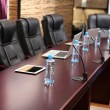 Empty conference room with laptops on table — Foto Stock