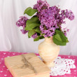Composition with lilacs on bright background — Stock Photo