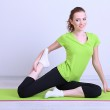 Portrait of beautiful young woman exercises — Stock Photo