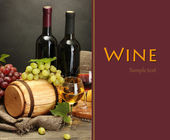 Still life of wine, grapes and cheese on wooden table on grey background — Stock Photo