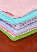 Kitchen towels, on wooden background — Stock Photo