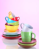 Mountain colorful dishes on pink background — Stock Photo