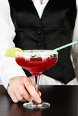 Barmen hand with shaker pouring cocktail into glass, on close up — Stock Photo