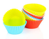 Stack of colorful cupcake cases isolated on white — Stock Photo