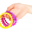 Colorful fashion bracelets on woman hand isolated on white — Stock Photo #26150729