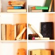 Stock Photo: Many books on white shelves