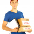 Young delivery man holding parcels and clipboard, isolated on white — Stock Photo #26151953