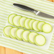 Fresh marrows on plate, on wooden background — Stock Photo #26152205