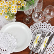 Table setting with chamomiles on wooden table background — Stock Photo #26152709