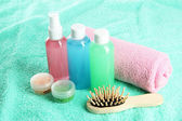Hotel cosmetics kit on blue towel — Stok fotoğraf