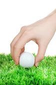 Pallina da golf in mano isolato su bianco — Foto Stock