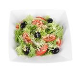 Light salad on plate isolated on white — Stock Photo