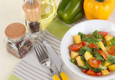 Light salad in plate on wooden table — Stock Photo