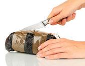 Pakketten van verdovende middelen in de hand geïsoleerd op wit — Stockfoto