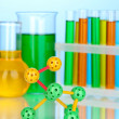 Molecule model and test tubes with colorful liquids on blue background — Foto Stock