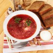 Delicious borsch on table close-up - Stock Photo