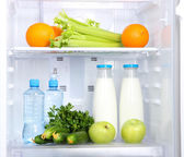 Open refrigerator with vegetarian food — Foto Stock